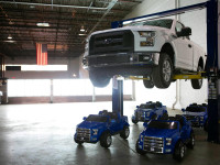 Four Little Power Wheels Ford F-150s Can Hold a Real & Big Ford F-150
